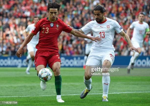 Portugal's midfielder Joao Felix challenges Switzerland's defender Ricardo Rodriguez during the UEFA Nations League semifinal football match between...