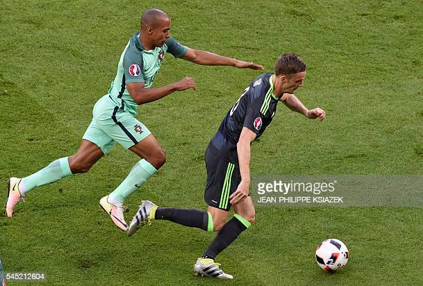 Portugal's midfielder Joao Mario and Wales' midfielder Andy King vie for the ball during the Euro 2016 semifinal football match between Portugal and...