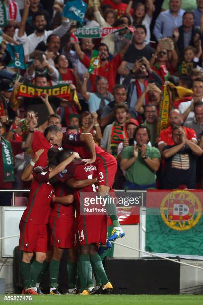 Portugal's midfielder Joao Mario celebrates with teammates after scoring during the 2018 FIFA World Cup qualifying football match between Portugal...