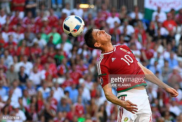 Portugal's midfielder Joao Mario heads the ball during the Euro 2016 group F football match between Hungary and Portugal at the Parc Olympique...