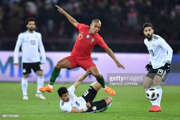 Portugal's midfielder Joao Mario jumps above Egypt's midfielder Tarek Hamed during their international friendly football match between Portugal and...