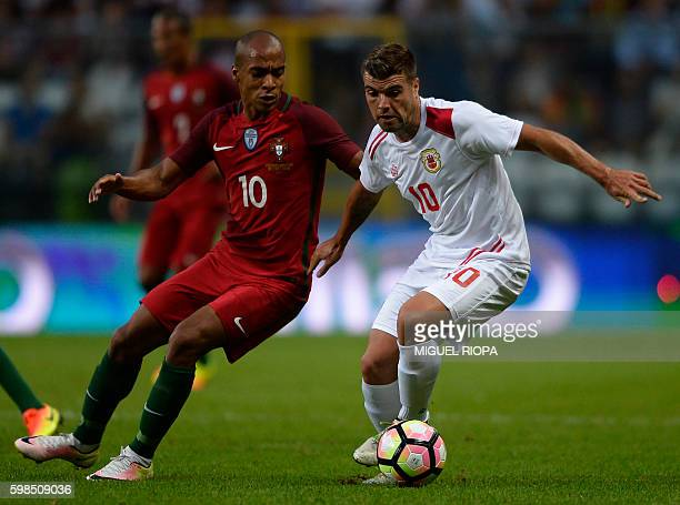 Portugal's midfielder Joao Mario vies with Gibraltar's midfielder Liam Walker during the friendly football match Portugal vs Gibraltar at Bessa...