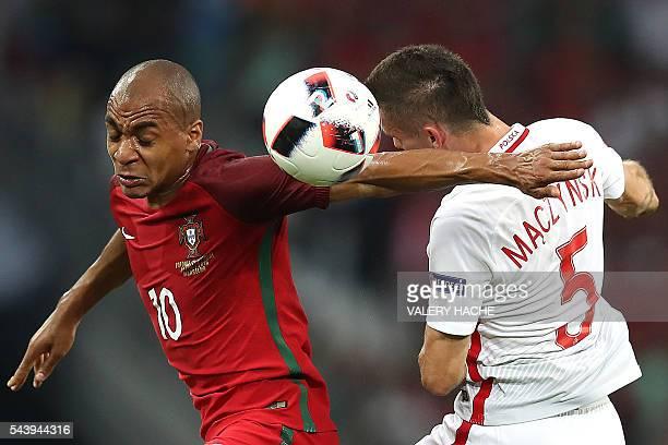 TOPSHOT Portugal's midfielder Joao Mario vies with Poland's midfielder Krzysztof Maczynski during the Euro 2016 quarterfinal football match between...