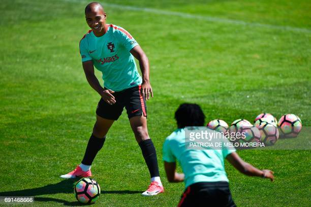 Portugal's midfielder Joao Mario warms up during a training session at Cidade do Futebol training camp in Oeiras outskirts of Lisbon on June 2 on the...