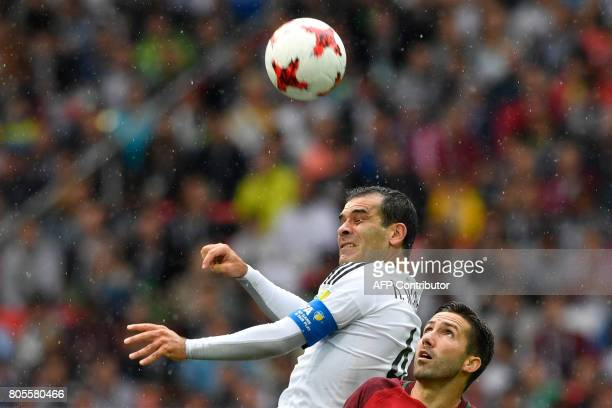 TOPSHOT Portugal's midfielder Joao Moutinho challenges Mexico's defender Rafael Marquez during the 2017 FIFA Confederations Cup third place football...