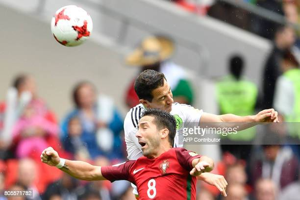 Portugal's midfielder Joao Moutinho heads the ball with Mexico's midfielder Andres Guardado during the 2017 FIFA Confederations Cup third place...