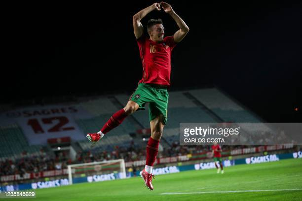Portugal's midfielder Joao Palhinha celebrates after scoring a goal during the FIFA World Cup Qatar 2022 qualification Group A football match between...