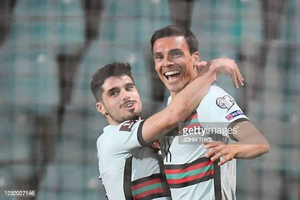 Portugal's midfielder Joao Palhinha celebrates with teammates after scoring a goal during the FIFA World Cup Qatar 2022 qualification Group A...