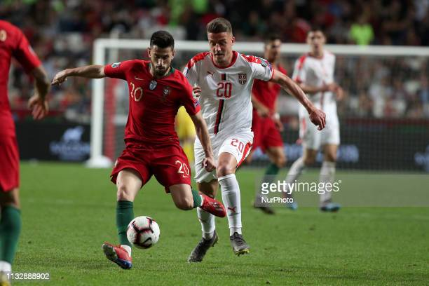 Portugal's midfielder Pizzi vies with Serbia's midfielder MilinkovicSavic during the UEFA EURO 2020 group B qualifying football match Portugal vs...