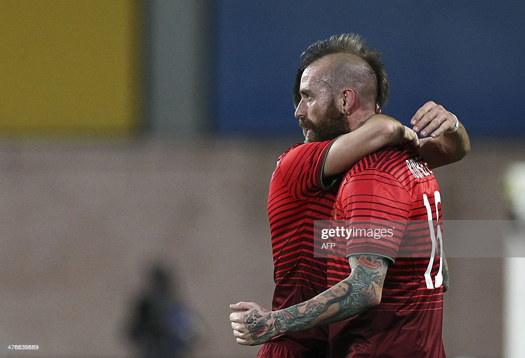 Portugal's midfielder Raul Meireles celebrates with a teammate after scoring during the FIFA 2014 World Cup friendly football match Portugal vs Cameroon at Magalhaes Pessoa stadium in Leiria on March 5, 2014.