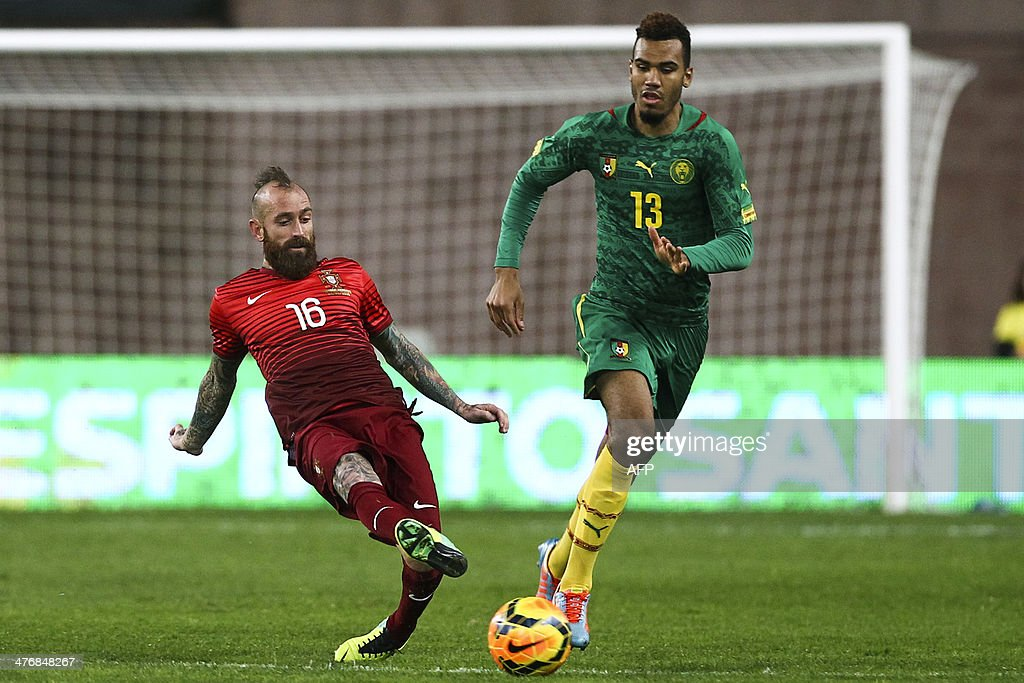 Portugal's midfielder Raul Meireles (L) vies with Cameroon's forward Eric-Maxim Choupo Moting (R) during the FIFA 2014 World Cup friendly football match Portugal vs Cameroon at Magalhaes Pessoa stadium in Leiria on March 5, 2014.