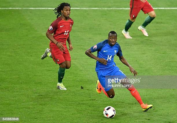 Portugal's midfielder Renato Sanches and France's midfielder Blaise Matuidi vie for the ball during the Euro 2016 final football match between...