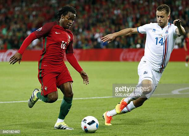Portugal's midfielder Renato Sanches and Iceland's defender Kari Arnason vie for the ball during the Euro 2016 group F football match between...