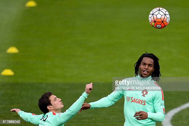 Portugal's midfielder Renato Sanches and Portugal's defender Cedric Soares take part in a training session at Restelo stadium in Lisbon on March 28...
