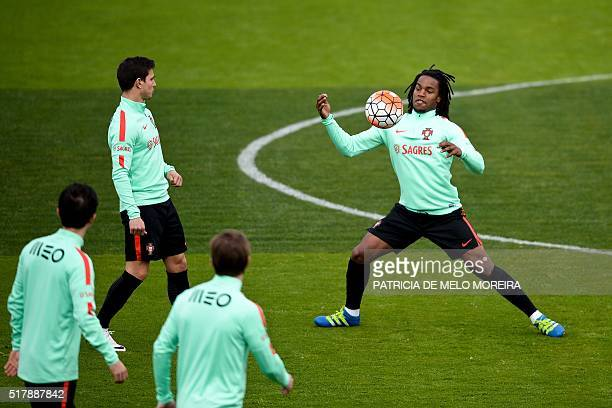 Portugal's midfielder Renato Sanches and teammates take part in a training session at Restelo stadium in Lisbon on March 28 on the eve of the...