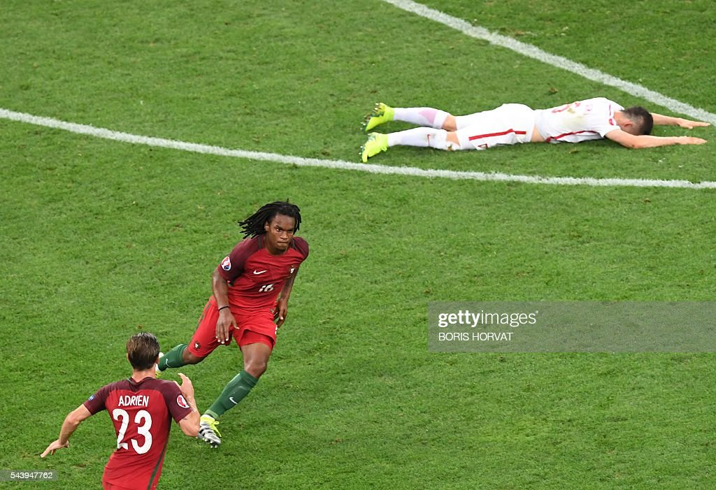 Portugal's midfielder Renato Sanches (C) celebrates next to Portugal's midfielder Adrien Silva after scoring during the Euro 2016 quarter-final football match between Poland and Portugal at the Stade Velodrome in Marseille on June 30, 2016. / AFP / BORIS