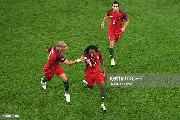 Portugal's midfielder Renato Sanches celebrates with Portugal's defender Pepe after scoring during the Euro 2016 quarterfinal football match between...
