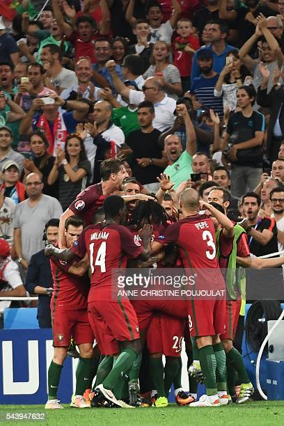Portugal's midfielder Renato Sanches celebrates with teammates after scoring his team's first goal during the Euro 2016 quarterfinal football match...