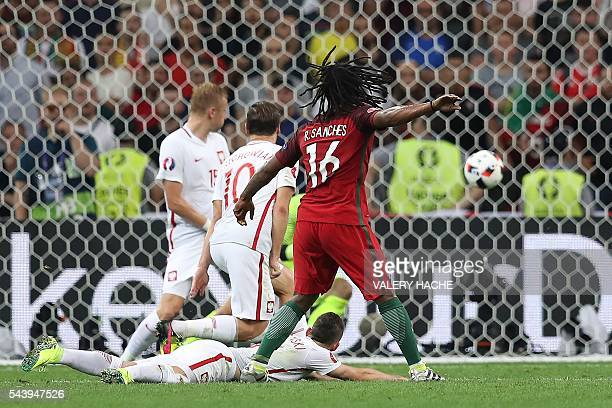 Portugal's midfielder Renato Sanches scores during the Euro 2016 quarterfinal football match between Poland and Portugal at the Stade Velodrome in...