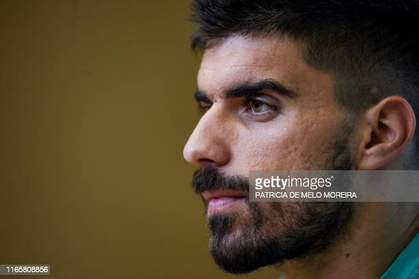"Portugal's midfielder Ruben Neves looks on during a press conference prior to a training session at ""Cidade do Futebol"" training camp in Oeiras,..."