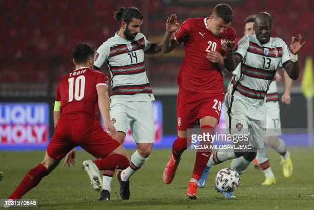 Portugal's midfielder Sergio Oliveira and Portugal's midfielder Danilo Pereira fight for the ball with Serbia's midfielder Sergej Milinkovic-Savic...