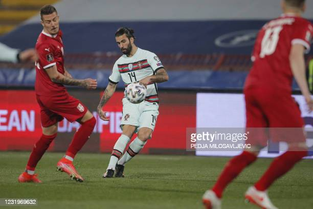 Portugal's midfielder Sergio Oliveira fights for the ball with Serbia's midfielder Sergej Milinkovic-Savic during the FIFA World Cup Qatar 2022...