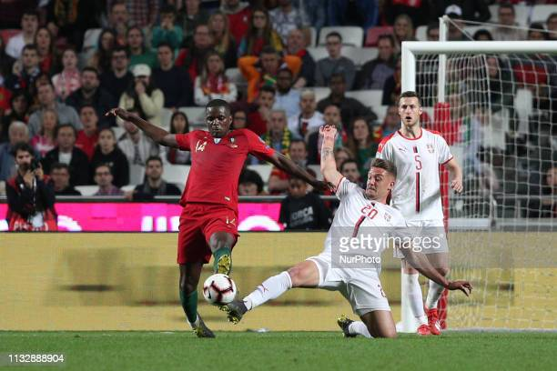 Portugal's midfielder William Carvalho vies with Serbia's midfielder MilinkovicSavic during the UEFA EURO 2020 group B qualifying football match...