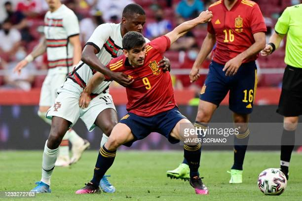 Portugal's midfielder William Carvalho vies with Spain's forward Gerard Moreno during the international friendly football match between Spain and...