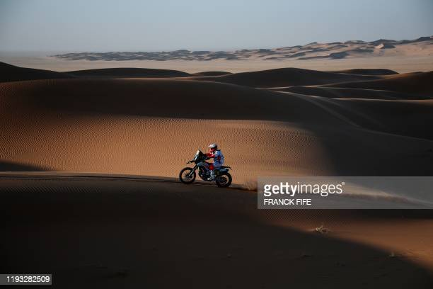 Portugal's motorbike rider Paulo Goncalves drives his Hero as he competes in the Stage 7 of the Dakar 2020 between Riyadh and Wadi Al Dawasir Saudi...