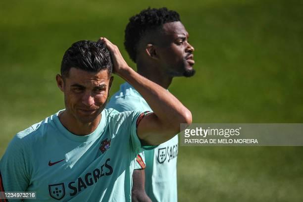 Portugal's national football team forward Cristiano Ronaldo and defender Nelson Semedo attend a training session at the Cidade do Futebol training...