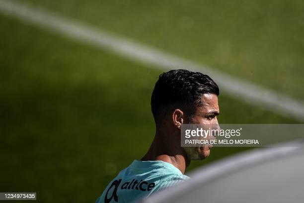 Portugal's national football team forward Cristiano Ronaldo attends a training session at the Cidade do Futebol training camp in Oeiras, outside...
