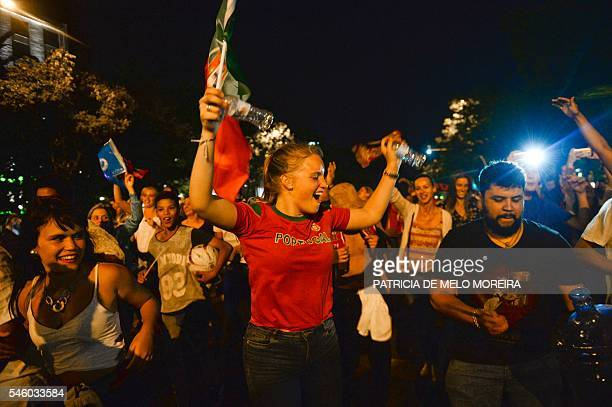 Portugal's national football team supporters celebrate their team's victory in Lisbon on July 10 2016 after the Euro 2016 final football match...