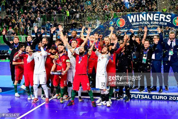 TOPSHOT Portugal's national futsal team celebrates after winning the European Futsal Championship at Arena Stozice in Ljubljana on February 10 2018 /...