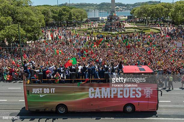 Portugal's National Soccer Team are cheered by fans on on their way to the presidential palace to be greeted and decorated with the Grand Cross of...
