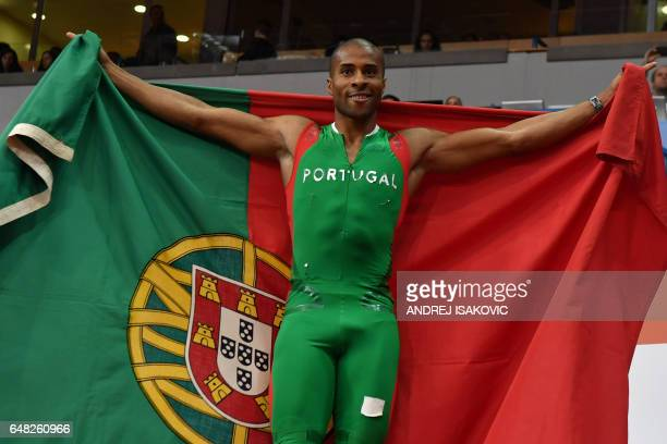 Portugal's Nelson Evora celebrates after winning the men's triple jump final at the 2017 European Athletics Indoor Championships in Belgrade on March...
