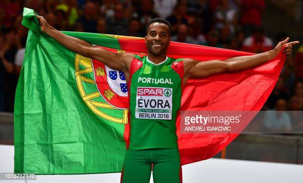 Portugal's Nelson Evora celebrates with his national flag after winning the men's Triple Jump final during the European Athletics Championships at...