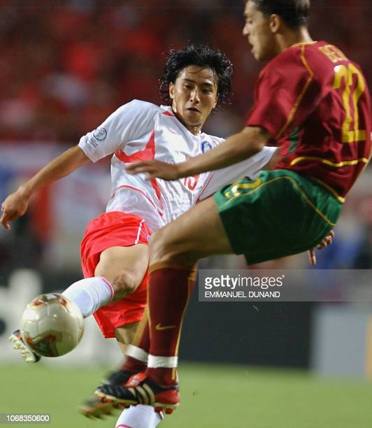 Portugal's Nuno Gomes vies for the ball with Korea's Ahn Jung Hwan 14 June 2002 at the Incheon Munhak Stadium in Incheon during first round Group D...