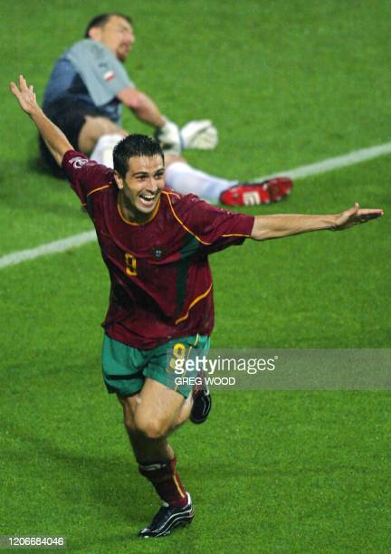 Portugal's Pauleta runs past Polish 'keeper Jerzy Dudek in celebration after scoring his third goal in the 76th minute, 10 June 2002 at the Jeonju...