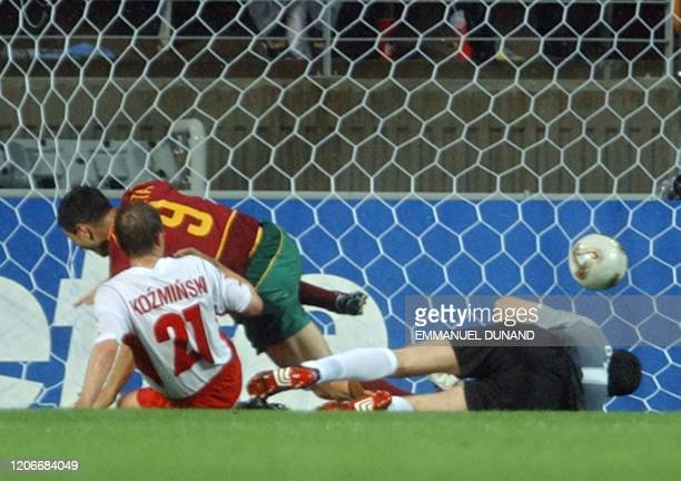 Portugal's Pauleta turns away after scoring in the 65th minute as Poland's 'keeper Jerzy Dudek and Marek Kozminski look on, 10 June 2002 at the...