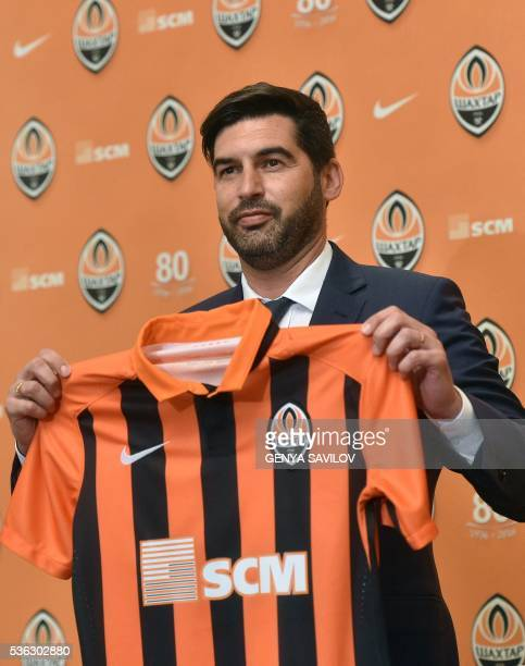 Portugal's Paulo Fonseca holds up a FC Shakhtar Donetsk jersey during a press conference on June 1 2016 in Kiev Shakhtar Donetsk have named...