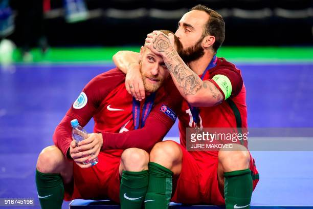 Portugals Pedro Cary and Ricardinho react after winning the European Futsal Championship at Arena Stozice in Ljubljana Slovenia on February 10 2018 /...
