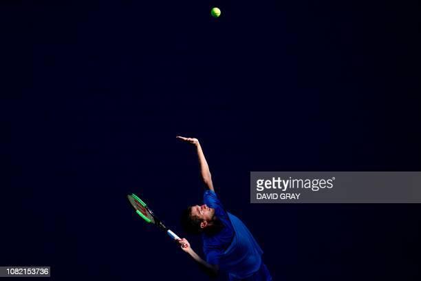 TOPSHOT Portugal's Pedro Sousa serves to Australia's Alex de Minaur during their men's singles match on day one of the Australian Open tennis...