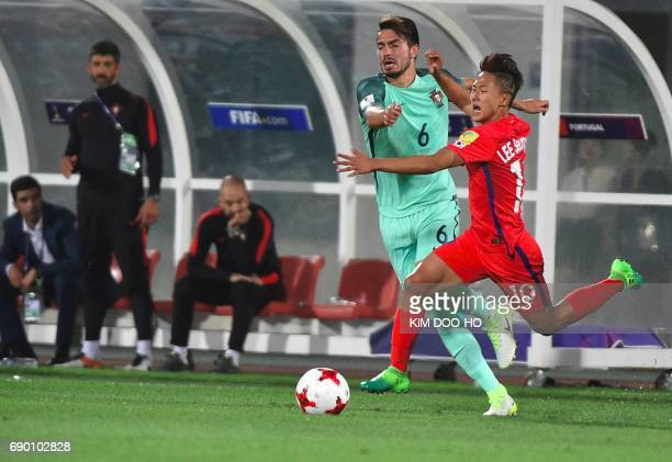 Portugal's Pepe fights for the ball with South Korea's Lee SeungWoo during the FIFA Under 20 World Cup round of 16 football match in Cheonan on May...