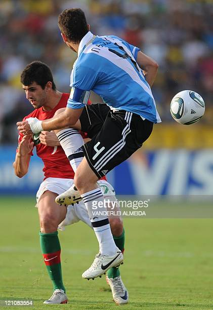 Portugal´s player Matias Laba vies for the ball with Hugo Nervo of Argentina during their FIFA World Cup U20 football match at Jaime Moron Olimpic...