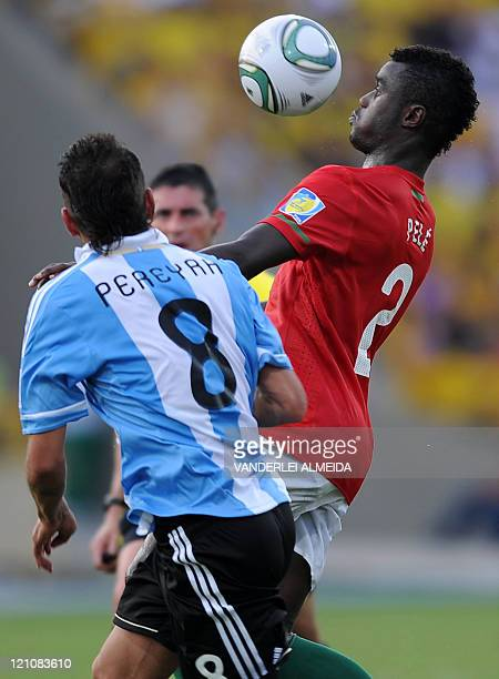 Portugal´s player Tucara Pele vies for the ball with Roberto Pereyra of Argentina during their FIFA World Cup U20 football match at Jaime Moron...