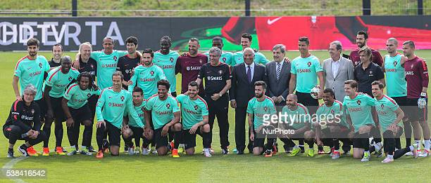 Portugal's players and staff pose for a team photo with Portugal's Prime Minister Antonio Costa during a Portugal training session in preparation for...