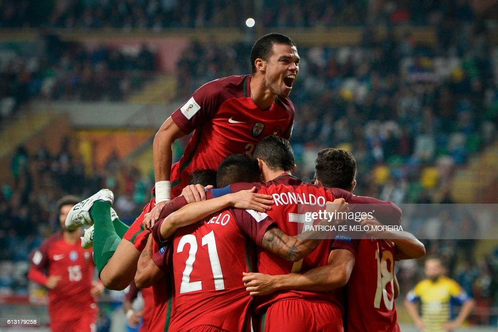 Portugal's players celebrate after a goal by Portugal's forward Cristiano Ronaldo during the WC 2018 football qualification match between Portugal and Andorra at the Municipal de Arouca stadium in Aveiro on October 7, 2016. MOREIRA