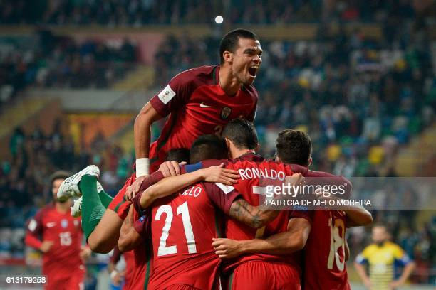 Portugal's players celebrate after a goal by Portugal's forward Cristiano Ronaldo during the WC 2018 football qualification match between Portugal...