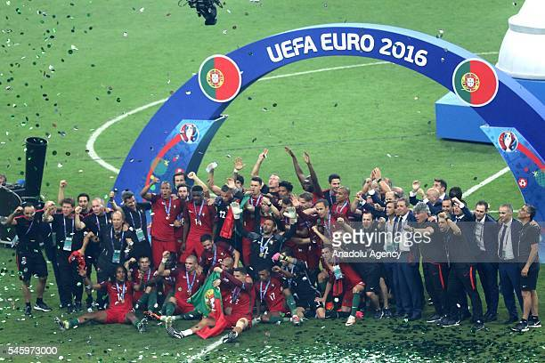Portugal's players celebrate after beating France during the Euro 2016 final football match at the Stade de France in SaintDenis north of Paris...
