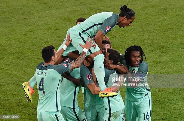 TOPSHOT Portugal's players celebrate after forward Nani scored a goal during the Euro 2016 semifinal football match between Portugal and Wales at the...